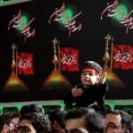 A Shia child mourning for Imam Hossein in front of the Leadership of Iran Imam Khamenei