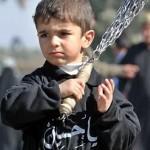 A Shia boy mourning for Imam Hussein in Muharram. Ya Hossein.
